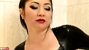 Asian BBW HD porn tube Wearing her latex body clothing this babe stuffs her fat toy in her hole